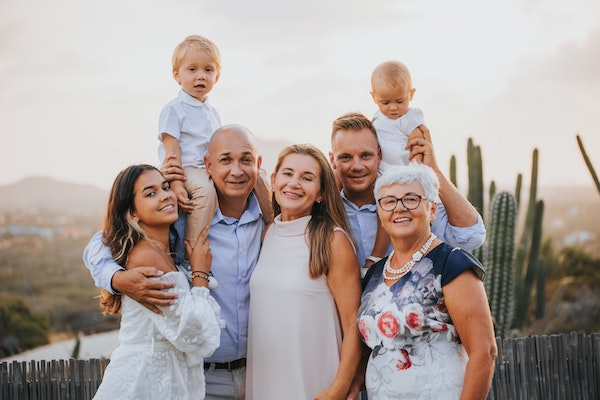 A multi-generational family gathering for a photo